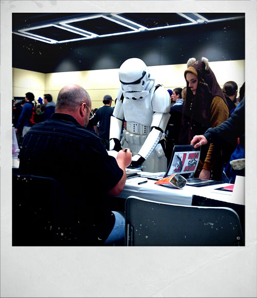 Storm trooper getting Matt Wagner to sign some comics