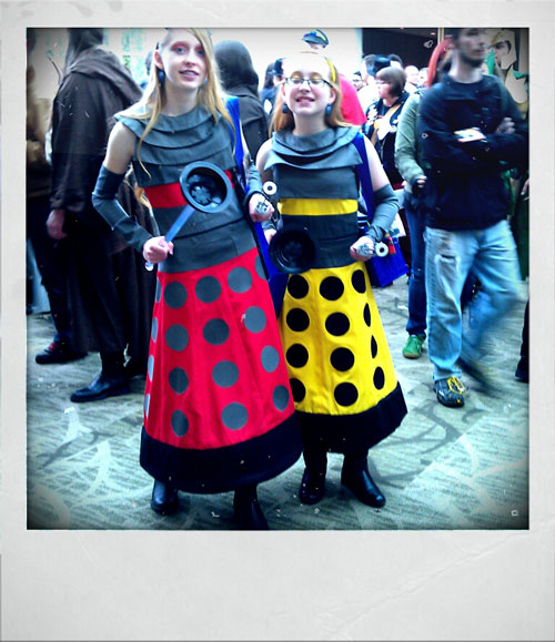 Two girls dressed up as daleks