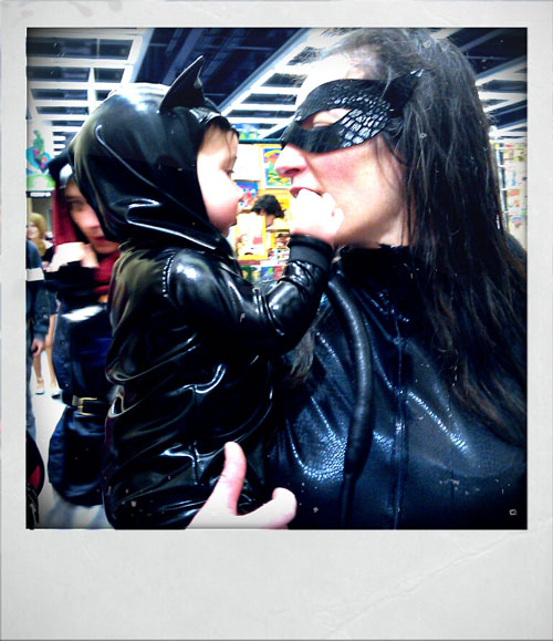 Mum and baby both dressed up as Catwoman