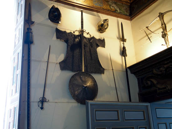 Chain mail surrounded by weapons