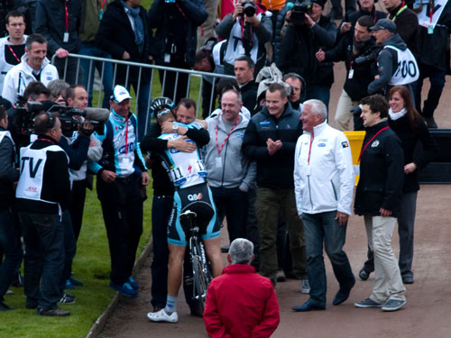 Boonen receiving a congrations hug